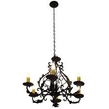 1980s black iron six light chandelier with leaves for
