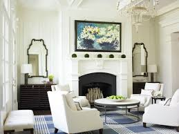 elegant living room photo in atlanta with white walls a standard fireplace and no tv