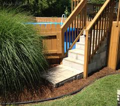 above ground pool steps. Concrete Steps Wood Deck And Landscaping Around Above Ground Pool
