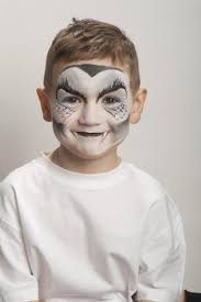 use a sponge and white face paint to cover the entire face avoiding the lips and eyes