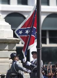 an honor guard from the south carolina highway patrol removes the confederate battle flag from the