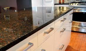 coffee brown granite white cabinets