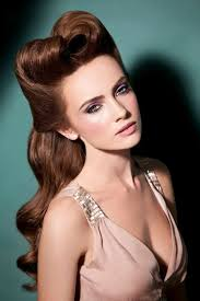 vine hairstyles long smooth brown hair with big lush curls and victory rolls young