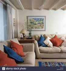 Red And Blue Living Room Blue And Red Cushions On Cream Sofas In A Traditional Living Room