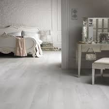 white washed laminate flooring it gives the space such a light and serene feel