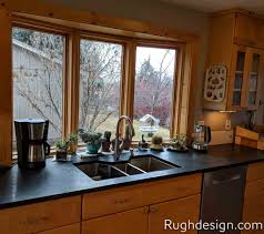 Light Yelloworange Toned Kitchen Cabinets With Cool Greige Wall