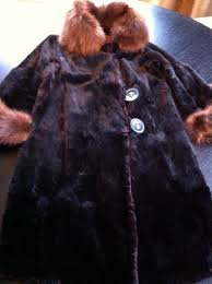 as a child my mother had a fox fur stole that she would wear to formal functions the little fox face that hung down the back of the stole with its glass