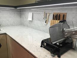 ... Corner kitchen with marble on backsplash and countertop