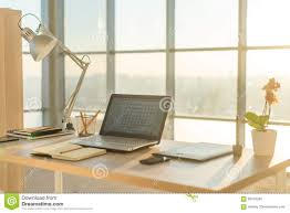 comfortable home office. Side View Picture Of Studio Workplace With Blank Notebook, Laptop. Comfortable Work Table, Home Office. Office H