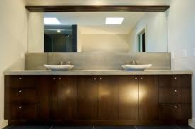 bathroom furniture popular design. custom bathroom cabinets in dark brown with stainless handles made and installed by evolve kitchens furniture popular design