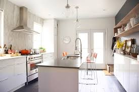 marion melbourne kitchen white no upper cabinets small island marble slab backsplash black dark quartz countertops