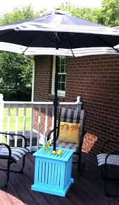 shade umbrella with stand umbrella stand black patio umbrella with teal table and striped chairs for