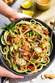 this asian zucchini noodle salad with thai peanut dressing is the perfect healthy and easy way