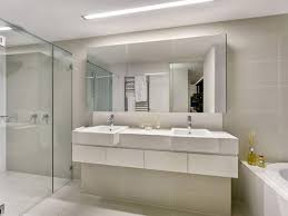 white floating vanity with excellent large bathroom mirror for white interior color combination with best reinforced glass shower doors