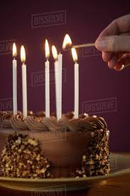 chocolate birthday cake with candles. Exellent Chocolate Studio Shot Of Man Igniting Candles On Chocolate Birthday Cake To Chocolate Birthday Cake With Candles N
