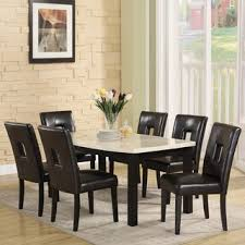 this beautiful dining table set features attractive black faux leather keyhole chairs giving it an elegant and contemporary look the set es with a table