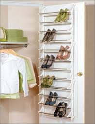 saving small closet spaces with stainless steel and plastic hanging shoe rack storage behind the door ideas