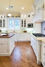 Cottage Kitchen Design With White Wooden Cabinet
