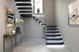 Floating treads staircase with glass balustrades to the stairs and top  landing contemporary-staircase