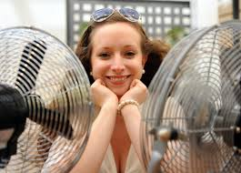 hot office pic. Soaring Temperatures Often Get Office Workers Hot Under The Collar. Picture: SONYA DUNCAN. Pic