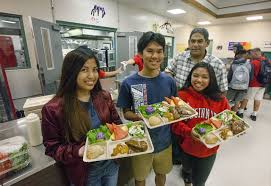 high school lunch table. HOLLYN JOHNSON/Tribune-Herald Keaau High School Seniors, From Left, Stecy Dingle, 16, Robert Macasieb, 17, And Mayann Tadeo, Food Service Manager Lunch Table