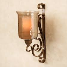 great scroll brushed bronze candle wall sconce design featuring glass