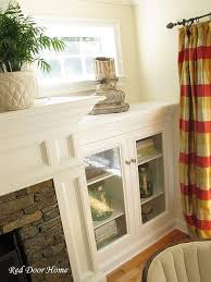 diy built in cabinets beside fire place