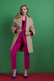 model wearing lipsy coat and bright pink suit