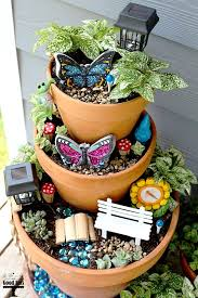 how to make your own diy fairy garden with items from the dollar i