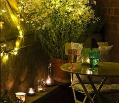 decorative lighting ideas. Glass Table With Decorative Potted Plants And Fairy Hanging Light Ideas For Excellent Backyard Lighting T