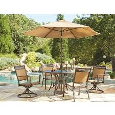 signature design by ashley carmadelia round 7 piece outdoor furniture set