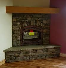 simple design stone tile corner fireplace with inserts like flat stone for the seating