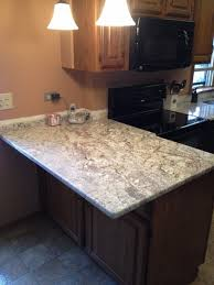 white spring countertop with dark oak cabinet in chicago il