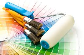 brushes and paint roller on a colour guide