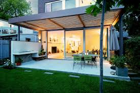 modern concrete patio designs. Modern Concrete Patio Designs With Slatted Wood Roof Potted Plants Sliding Glass Doors E