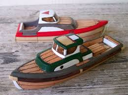 wooden toy boats by friendlyfairies carved in oregon from solid wood then wood burned to create the effect of planks and nails eac