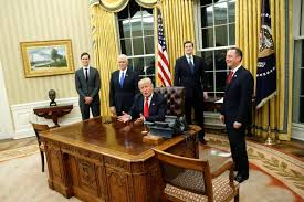 us president office. The Churchill Bust Is Seen In Oval Office As U.S. President Donald Trump Signs His Us
