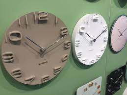 brown and white karlsson clocks