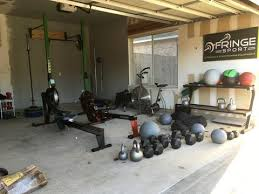 This home gym was created by green retreats. 7 Steps To Convert Your Garage To A Gym