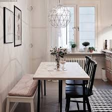 love the light fixture and seating styles how to style a small dining e like the bench and chairs and chandelier