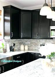 dark grey granite countertops kitchen cabinets white black with quartz oak hardwood floor brass accents and