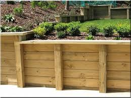 best 25 wood retaining wall ideas on sleeper wall wood retaining wall