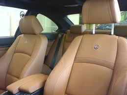 tan leather front seats of vehicle