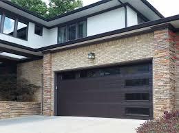 brick wall modern side garage combined with black door it black garage doors on red brick house
