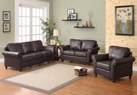 Furniture. Accent Wall With Brown Furniture presenting black leather sofa  and beige rug on brown