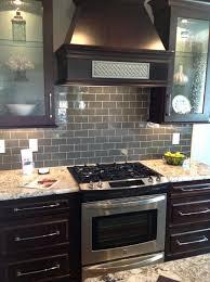glass tiles for backsplashes for kitchens ice gray glass subway tile dark  brown cabinets subway tile