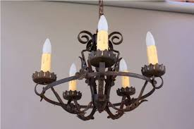 antique iron chandelier with candles