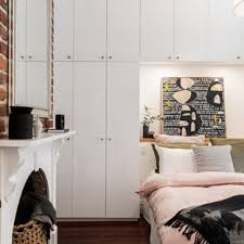 Image Hidden Small Eclectic Master Dark Wood Floor And Brown Floor Bedroom Photo In Perth With White Walls Houzz Floor To Ceiling Cabinets Bedroom Ideas And Photos Houzz