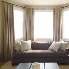 Bay window with custom drapery and hardware ...