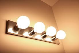 G30 LED Vanity Bulb w/ High CRI - 45 Watt Equivalent - Dimmable: Shown  Installed In Bathroom Vanity.